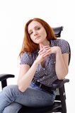Cute woman in the chair Royalty Free Stock Photo