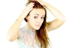 Cute woman checking hair loss Royalty Free Stock Image