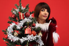 Cute woman and christmas tree Royalty Free Stock Photos