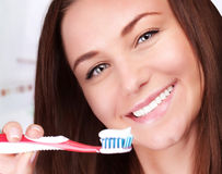 Cute woman clean teeth Stock Image
