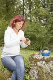 Cute woman cleaning Boletus Edulis Royalty Free Stock Photography