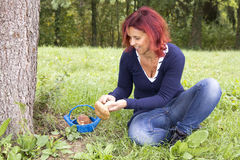 Cute woman cleaning Boletus Edulis Stock Photo