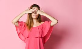 Girl covering her eyes stock photos