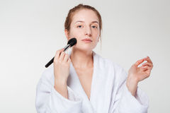 Cute woman with cosmetic brush Royalty Free Stock Photo