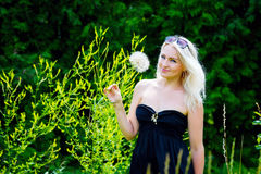 Cute woman with dandelions Royalty Free Stock Photo