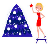 Cute Woman decorating Christmas tree. Royalty Free Stock Image