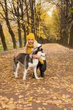 Cute woman and dog in the park. Cute woman and dog in the autumn park Royalty Free Stock Image