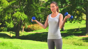 Cute woman doing musculation exercises Stock Image