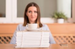 Cute woman drink a coffee before working Royalty Free Stock Image