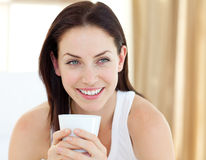 Cute woman drinking a coffee Stock Image