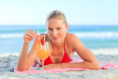 Cute woman drinking her cocktail Stock Photo