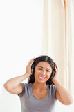 Cute woman with earphones looking into camera Royalty Free Stock Images