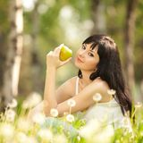 Cute woman in the park with dandelions Stock Images