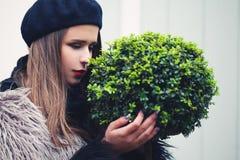 Cute Woman Embracing Green Plant Tree. Environmental Concept Stock Photo