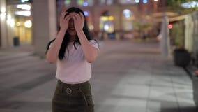 Cute woman enjoy a night walk. In a city stock footage
