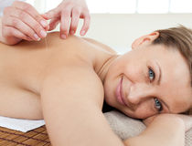 Cute woman enjoying a back massage in a Spa c Stock Images