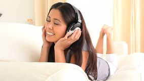 Cute woman enjoying some music stock video