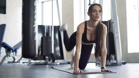Cute woman exercising in the gym