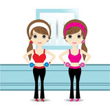 Cute Woman exercising in sport outfit holding dumbbell smiling Stock Images