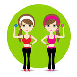Cute Woman exercising in sport outfit holding dumbbell smiling Royalty Free Stock Photo