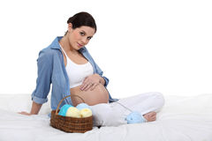 Cute woman expecting baby Stock Images