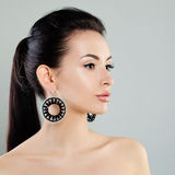 Cute Woman Fashion Model with Makeup and Earrings Royalty Free Stock Images