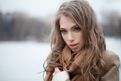 Cute woman fashion model in winter park. royalty free stock photography