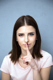 cute woman with finger over lips Stock Image
