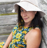Cute woman in floral sundress and hat smiling Stock Image