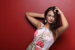 Cute woman in flower dress Stock Image