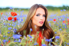 Cute woman on flower field Stock Photo
