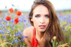 Cute woman on flower field Royalty Free Stock Photography