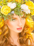 Cute woman with flowers on hair looking away Royalty Free Stock Photo