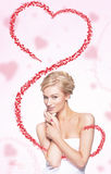 Cute woman with flying heart. Cute young blond woman holding flying heart Stock Images
