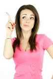 Cute woman with funny face point white space. Fresh smiling cute woman pointing Royalty Free Stock Photography