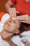Cute woman gets professional facial massage, lymphatic drainage Stock Photography