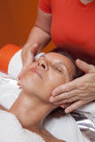 Cute woman gets professional facial massage, lymphatic drainage Stock Images