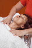 Cute woman gets professional facial massage, lymphatic drainage Stock Photo