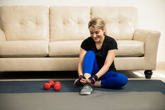Cute woman getting ready to exercise at home Royalty Free Stock Photos