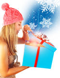 Cute woman getting Xmas gift Royalty Free Stock Photo