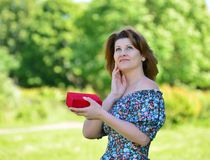 Cute woman with gift at summer park Royalty Free Stock Images