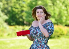 Cute woman with gift at summer park Royalty Free Stock Photo
