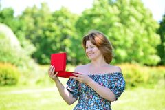 Cute woman with gift at summer park Royalty Free Stock Image