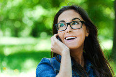 Cute woman glasses talking phone Royalty Free Stock Images