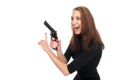 Cute woman with a gun Royalty Free Stock Photos