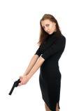 Cute woman with a gun Stock Photo