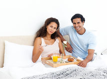 Cute woman having breakfast on the bed Royalty Free Stock Photo