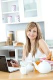 Cute woman having breakfast in the kitchen Stock Photo
