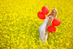 Cute woman having fun in spring field Stock Photos