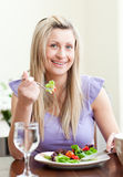 Cute woman having an healthy dinner Stock Photos